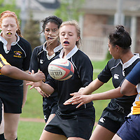 Paige Chmiel from St. Roch SS going for the ball in ROPSSAA senior girls's rugby against Holy Name of Mary SS. Watching on from St Roch are Suzanne Queen and Jacqueline Owens.