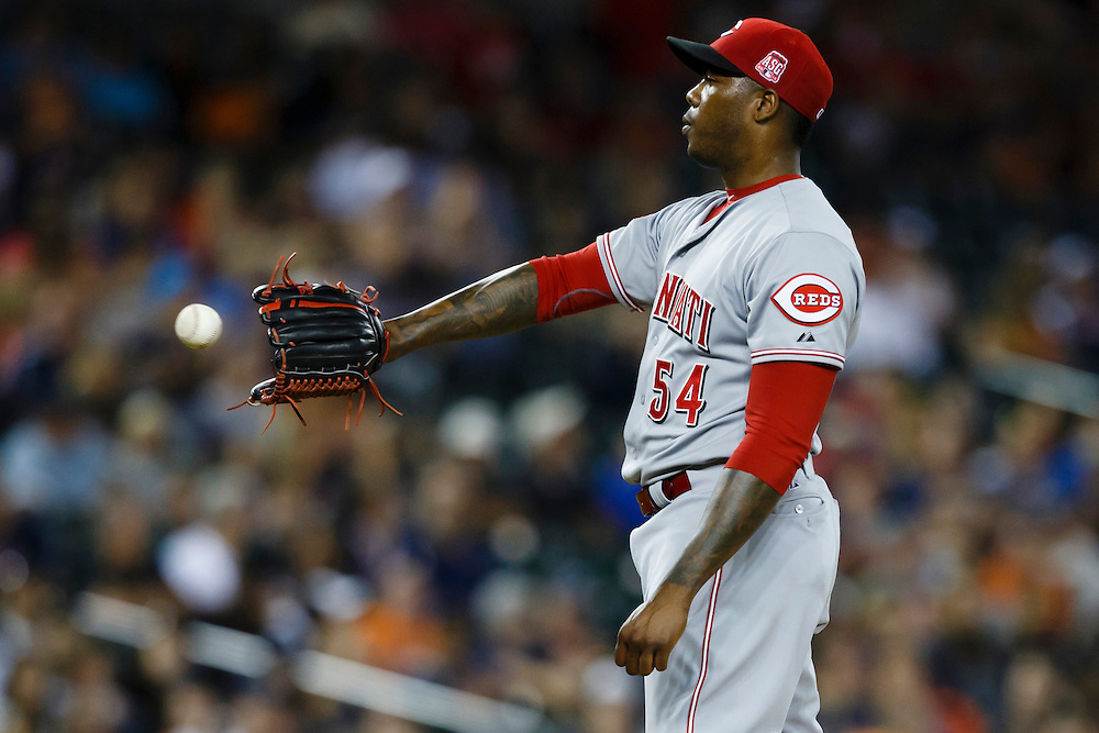 Jun 16, 2015; Detroit, MI, USA; Cincinnati Reds relief pitcher Aroldis Chapman (54) get the ball back from catcher Brayan Pena (not pictured) in the ninth inning against the Detroit Tigers at Comerica Park. Cincinnati won 5-2. Mandatory Credit: Rick Osentoski-USA TODAY Sports