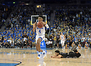 Nov 15, 2017; Los Angeles, CA, USA; UCLA Bruins guard Jaylen Hands (4) dribbles down court with Central Arkansas Bears guard Jordan Howard (1) in pursuit in the final seconds of regulation during a NCAA basketball at Pauley Pavilion. UCLA defeated Central Arkansas 106-101 in overtime.
