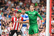 Queens Park Rangers Goalkeeper Alex Smithies (1), Queens Park Rangers Midfielder Massimo Luongo (21) and Brentford Forward Neal Maupay (9) await a corner kick during the EFL Sky Bet Championship match between Brentford and Queens Park Rangers at Griffin Park, London, England on 21 April 2018. Picture by Stephen Wright.
