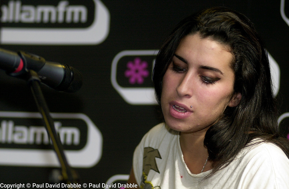 Amy Winehouse performs an Intimate concert at Sheffields Hallam FM Local Radio Station..14 October 2004.This Images is Copyright Paul David Drabble