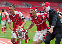 Football - 2017 FA Cup Final - Arsenal vs. Chelsea<br /> <br /> Mesut Ozil, Granit Xhaka and Shkodran Mustafi of Arsenal with the FA Cup at Wembley.<br /> <br /> COLORSPORT/DANIEL BEARHAM