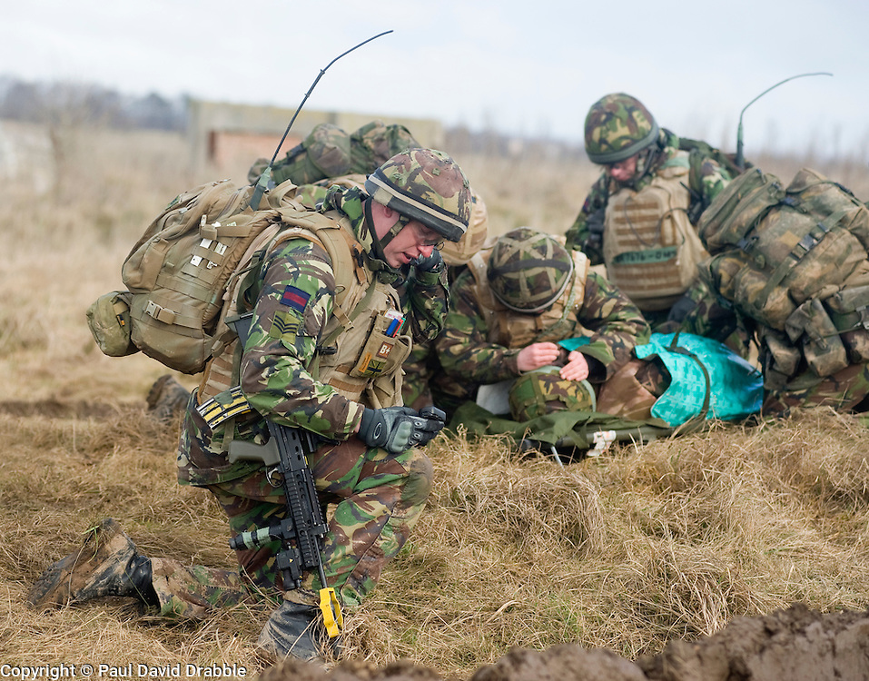 4 Mech Bde taking part in the Mission Specific Training on Salisbury Plain Training Area before deployment to Helmand Province Afghanistan. A simulated battle casualty is treated in the field after being pulled to safety before being evacuated by helicopter . 9 Feb 2010