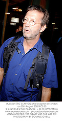 Musician ERIC CLAPTON at a reception in London on 30th August 2002.PCS 53