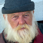 "Portrait of a homeless street person, a.k.a. ""Santa Claus"" on the Atlantic City Boardwalk in November. Looking into the camera with eye contact and distrust."
