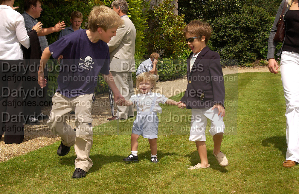 Henry Hall, Cy Busson and Flynn Busson, Cartier Style Et Luxe, Goodwood, 27 June 2004. SUPPLIED FOR ONE-TIME USE ONLY-DO NOT ARCHIVE. © Copyright Photograph by Dafydd Jones 66 Stockwell Park Rd. London SW9 0DA Tel 020 7733 0108 www.dafjones.com