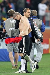 07.07.2010, Moses Mabhida Stadium, Durban, SOUTH AFRICA, Deutschland ( GER ) vs Spanien ( ESP ) im Bild Bastian Schweinsteiger of Germany is consoled after the final whistle mit Hans-Dieter Flick ( Assistenz Trainer - GER ).Foto ©  nph /  Kokenge / SPORTIDA PHOTO AGENCY
