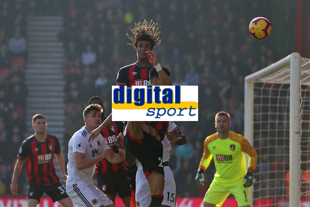 Football - 2018 / 2019 Premier League - AFC Bournemouth vs. Wolverhampton Wanderers<br /> <br /> Bournemouth's Nathan Ake heads a corner clear during the Premier League match at the Vitality Stadium (Dean Court) Bournemouth  <br /> <br /> COLORSPORT/SHAUN BOGGUST