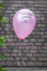 © Licensed to London News Pictures . 09/08/2013 . Salford , UK . Dozens of pink balloons are released following the service . The funeral of Linzi Ashton at St Paul's C of E Church in Salford , today (9th August 2013) . Linzi Ashton (25) was found murdered in her home on Westbourne Road in Salford on 29th June . Michael Cope is standing trial, accused of murdering, raping and assaulting her . Photo credit : Joel Goodman/LNP