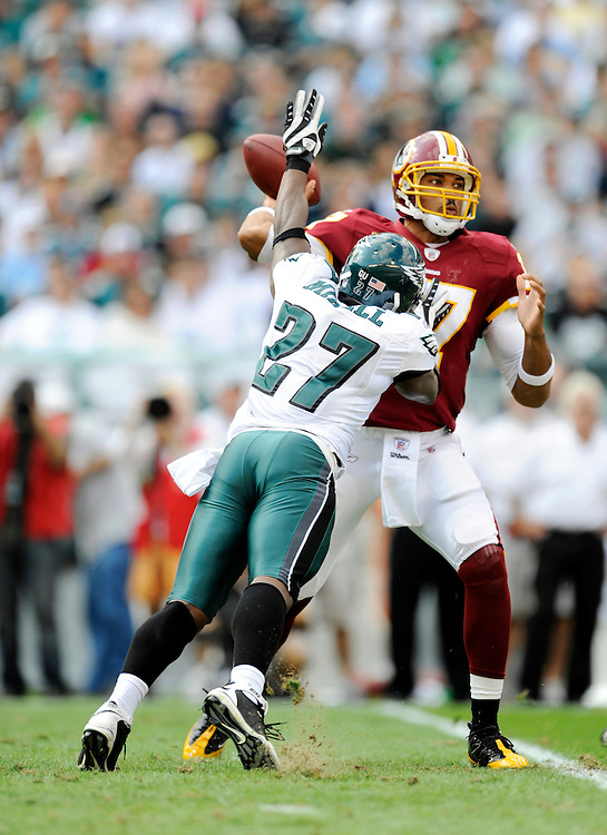 PHILADELPHIA - OCTOBER 5: Jason Campbell #17 of the Washington Redskins passes as Quintin Mikell #27 of the Philadelphia Eagles puts pressure on him on October 5, 2008 at Lincoln Financial Field in Philadelphia, Pennsylvania. The Redskins won 23-17. *** Local Caption *** Jason Campbell;Quintin Mikell