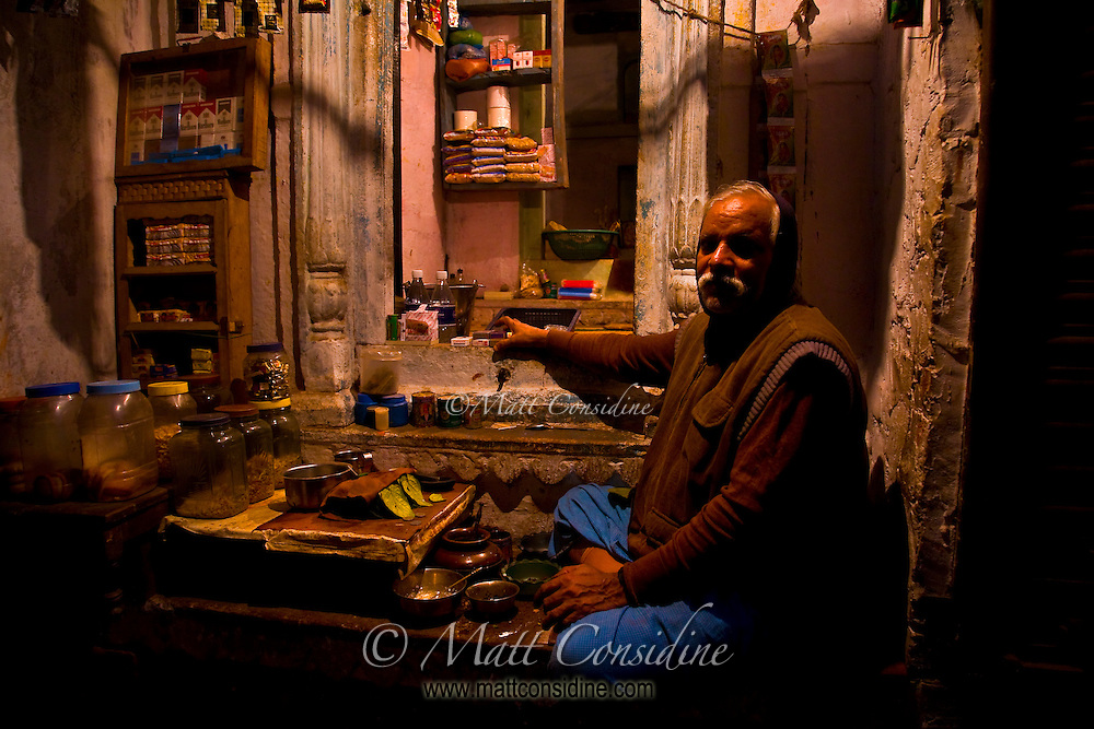 It is wonderful to wander deep into the dark backstreets of Varanasi and to discover these  dimly lit stalls, emerging like beacons from night. I could imagine that these stalls may have well been carrying on the same business wilh only minor changes for thousands of years.<br /> (Photo by Matt Considine - Images of Asia Collection)