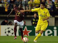 Villarreal vs Arsenal Champios league semifinals match at Villarreal the Arsenal pass to the final.- Riquelme trying to control the ball with the opposition of Emmanuel EBOUE