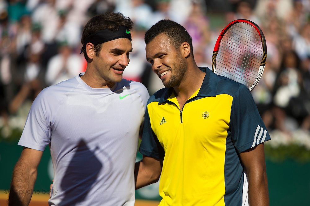 Paris, France. Roland Garros. June 4th 2013.<br /> French player Jo-Wilfried TSONGA (right) won against Roger FEDERER
