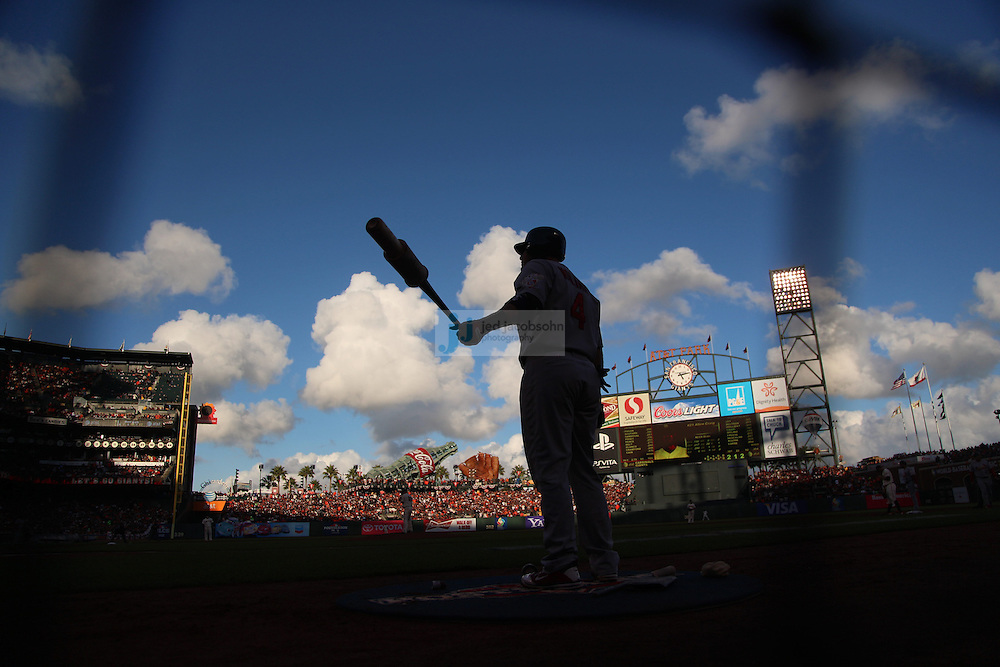 A batter is seen on deck during the San Francisco Giants and the St. Louis Cardinals Game Seven of the National League Championship Series at AT&T Park on October 22, 2012 in San Francisco, California.  (photo by Jed Jacobsohn)