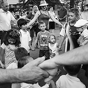 "Campers and visitors dance in a circle while holding hands during""Collage"" outside of Kresge Auditorium at Interlochen Center for the Arts in Interlochen, Michigan. ""Collage,"" is one of Interlochen's most popular annual Camp events, showcasing a sample of student performances encompassing music, dance, theatre, creative writing, motion picture arts, and visual arts."