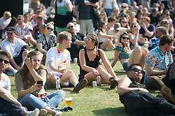Festival goers enjoying the music and sun on day 2 of All Points East festival in Victoria Park in London, UK. Picture date: Saturday 26 May 2018. Photo credit: Katja Ogrin/ EMPICS Entertainment.