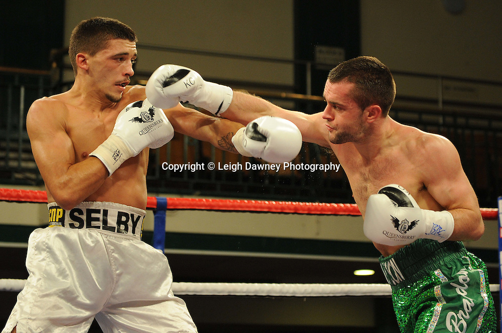Lee Selby (white shorts) defeats John Simpson for The British & Commonwealth Featherweight Title at York Hall, Bethnal Green, London on 14th December 2011. Frank Warren Promotions. Photo credit: © Leigh Dawney 2011.