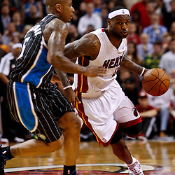 March 3, 2011; Miami, FL, USA; Miami Heat small forward LeBron James (6) drives past Orlando Magic shooting guard Quentin Richardson (5) during a game at the American Airlines Arena. The Magic defeated the Heat 99-96.    Mandatory Credit: Derick E. Hingle