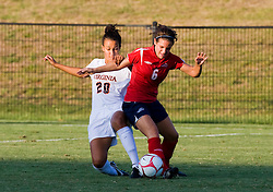 Liberty Flames defender Emily House (6) fights off Virginia Cavaliers midfielder/forward Kika Toulouse (20) for possession.  The Virginia Cavaliers defeated the Liberty Flames 5-0 in women's soccer at Klockner Stadium on the Grounds of the University of Virginia in Charlottesville, VA on August 29, 2008.