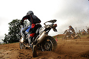 Bill Dragoo blasts off from a standstill in the deep sugar sand at the BMW Performance Test Center during the GS Challenge test in Spartanburg, SC.  He is racing eventual event winner and team USA caption Brad ?