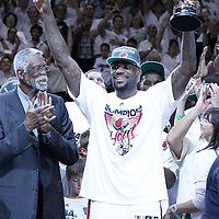 21 June 2012: Miami Heat small forward LeBron James (6) celebrates holding the NBA Finals MVP trophy next to Bill Russell after the Miami Heat 121-106 victory over the Oklahoma City Thunder, in Game 5 of the 2012 NBA Finals, at the AmericanAirlinesArena, Miami, Florida, USA. The Miami Heat wins the series 4-1.