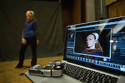 Attendees pose for their portrait at the Photography Department's booth during Humanities & Arts Day Student Showcase at San Jose State University's Student Union Barrett Ballroom in San Jose, California, on October 25, 2013. (Stan Olszewski/SOSKIphoto)