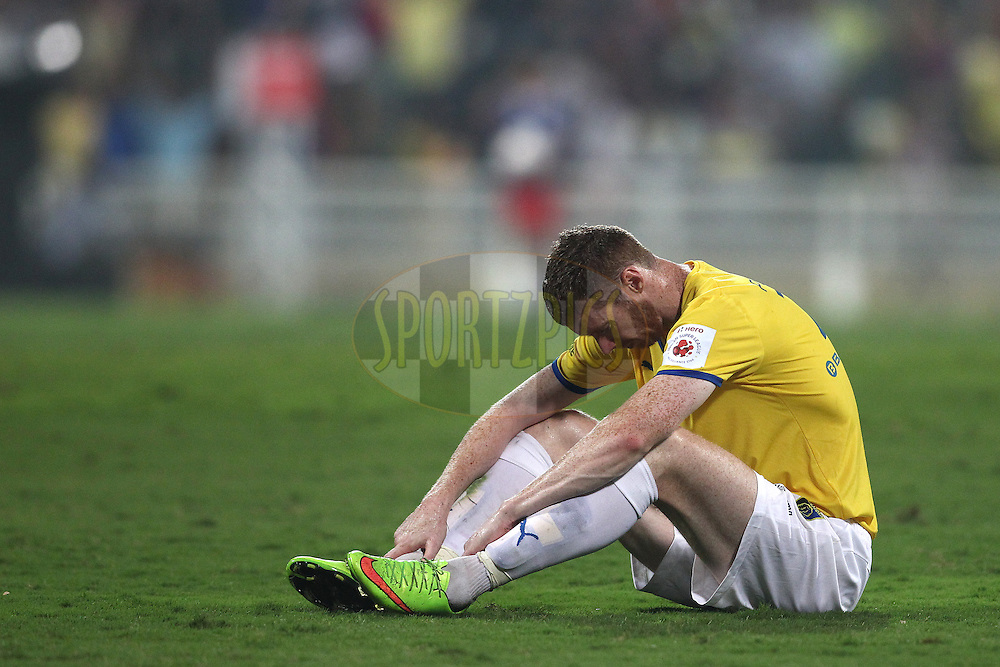A dejected Stephen Pearson of Kerala Blasters FC reacts after the final whistle as Atletico de Kolkata beat Kerala Blasters FC to become ISL Champions during the final of the Hero Indian Super League between Kerala Blasters FC and Atletico de Kolkata held at the D.Y. Patil Stadium, Navi Mumbai, India on the 2oth December 2014.<br /> <br /> Photo by:  Shaun Roy / ISL/ SPORTZPICS