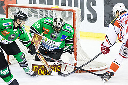 16.12.2014, Hala Tivoli, Ljubljana, SLO, EBEL, HDD Telemach Olimpija Ljubljana vs EC KAC, 28. Runde, in picture Thomas Hundertpfund (EC KAC, #27) vs Andy Chiodo (HDD Telemach Olimpija, #40) during the Erste Bank Icehockey League 28. Round between HDD Telemach Olimpija Ljubljana and EC KAC at the Hala Tivoli, Ljubljana, Slovenia on 2014/12/16. Photo by Matic Klansek Velej / Sportida