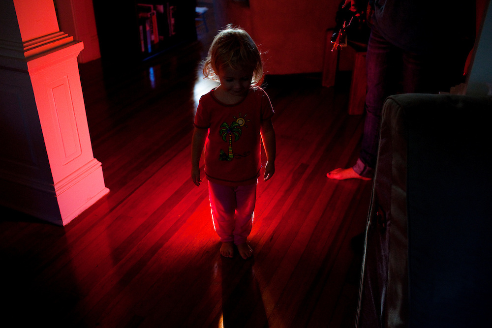 Madelyn Avery Eich, 2, stands in a shaft of light in Norfolk, Virginia on Monday, September 20, 2010.