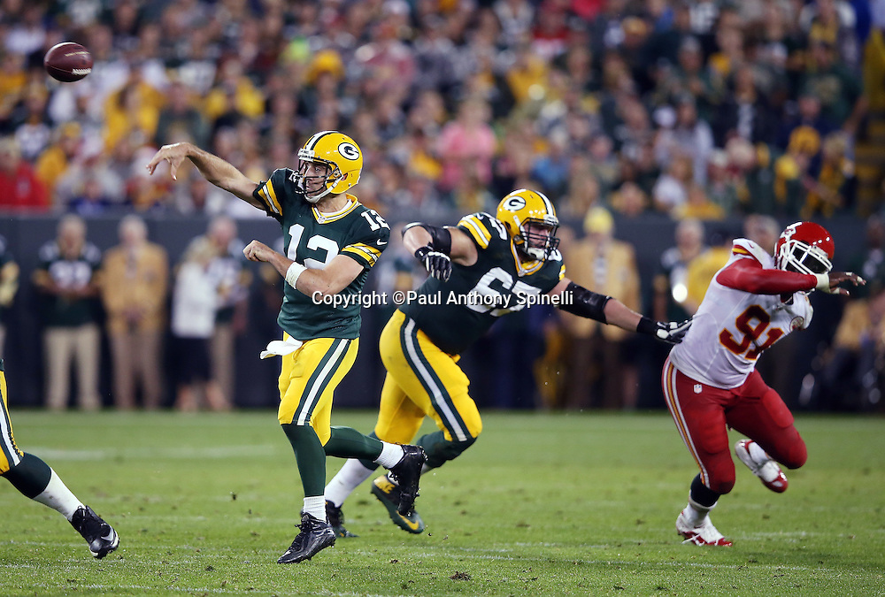 Green Bay Packers quarterback Aaron Rodgers (12) throws a pass while protected by Green Bay Packers tackle Don Barclay (67) blocking Kansas City Chiefs outside linebacker Tamba Hali (91) during the 2015 NFL week 3 regular season football game against the Kansas City Chiefs on Monday, Sept. 28, 2015 in Green Bay, Wis. The Packers won the game 38-28. (©Paul Anthony Spinelli)