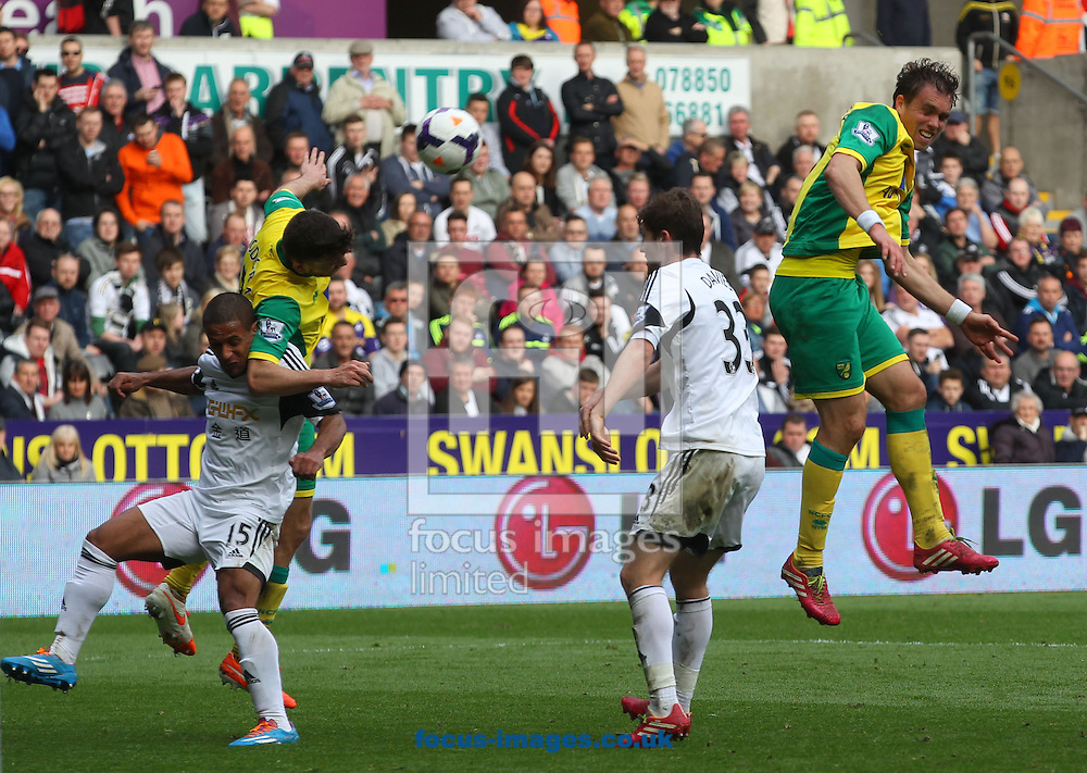 Johan Elmander of Norwich heads for goal during the Barclays Premier League match at the Liberty Stadium, Swansea<br /> Picture by Paul Chesterton/Focus Images Ltd +44 7904 640267<br /> 29/03/2014