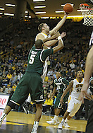 February 2 2011: Iowa Hawkeyes forward Andrew Brommer (20) puts up a shot as Michigan State Spartans center Adreian Payne (5) defends during the first half of an NCAA college basketball game at Carver-Hawkeye Arena in Iowa City, Iowa on February 2, 2011. Iowa defeated Michigan State 72-52.
