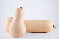 Two butternut pumpkins over white background