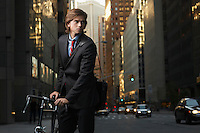 Young Businessman Bicycling to Work