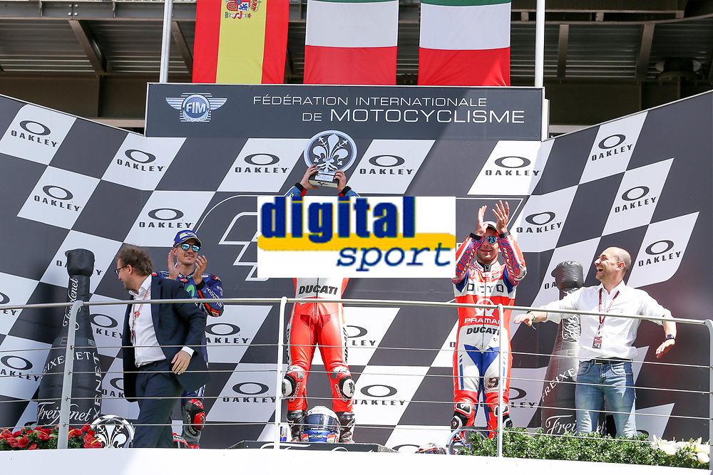 Ducati's Team rider Italian Andrea Dovizioso, winner, Maverick Vinales of Spain  and Movistar Yamaha MotoGP second, Danilo Petrucci of Italy and OCTO Pramac Racing third during the Moto GP Grand Prix at the Mugello race track on June 4, 2017 celebrates on the podium. <br /> MotoGP Italy Grand Prix 2017 at Autodromo del Mugello, Florence, Italy on 4th June 2017. <br /> Photo by Danilo D'Auria.<br /> <br /> Danilo D'Auria/UK Sports Pics Ltd/Alterphotos