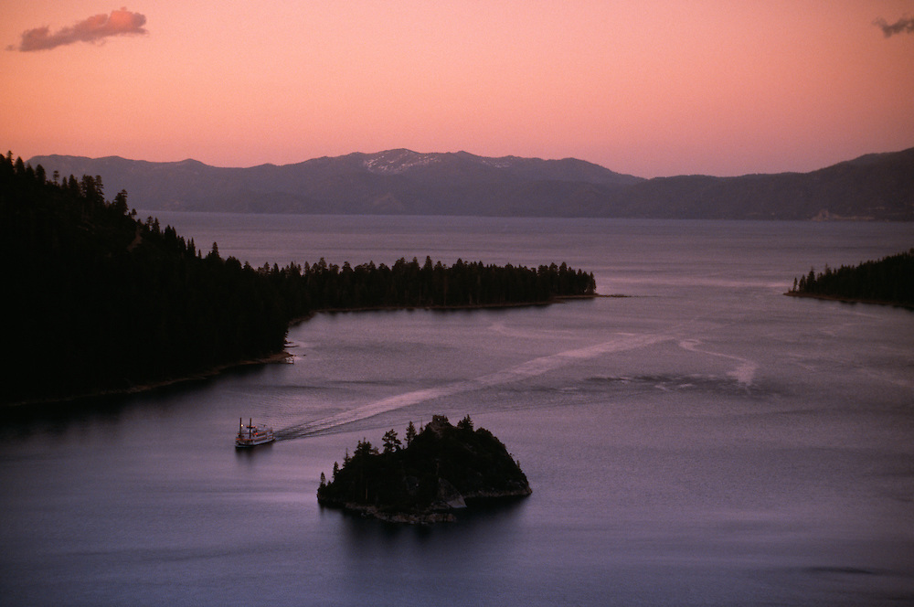 USA, California, silhouette of island with boat in Lake Tahoe at dawn