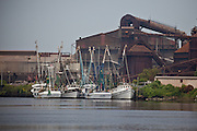 Shrimp boats tied up in the Sampit River harbor near the closed steel mill in Georgetown, SC