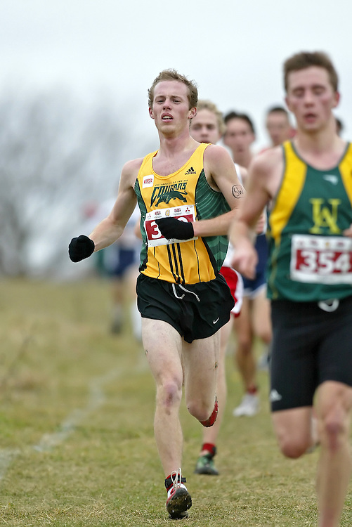 (Kingston, Ontario -- 14 Nov 2009)  DALE WIG of the University of Regina runs to 21 place at the  2009 Canadian Interuniversity Sport CIS Cross Country Championships at Forth Henry Hill in Kingston Ontario. Photograph copyright Sean Burges / Mundo Sport Images, 2009.