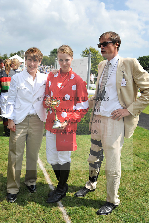 EDIE CAMPBELL with her parents RODDY CAMPBELL and SOPHIE HICKS at the 3rd day of the 2011 Glorious Goodwood Racing Festival - Ladies Day at Goodwood Racecourse, West Sussex on 28th July 2011.