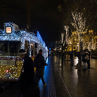 BUDAPEST, HUNGARY - DECEMBER 07:  Two passer by walk in front of the traditional special festive Christmas lit Tram n2  on December 7, 2017 in Budapest, Hungary. The traditional Christmas market and lights will stay until 31st December 2017.