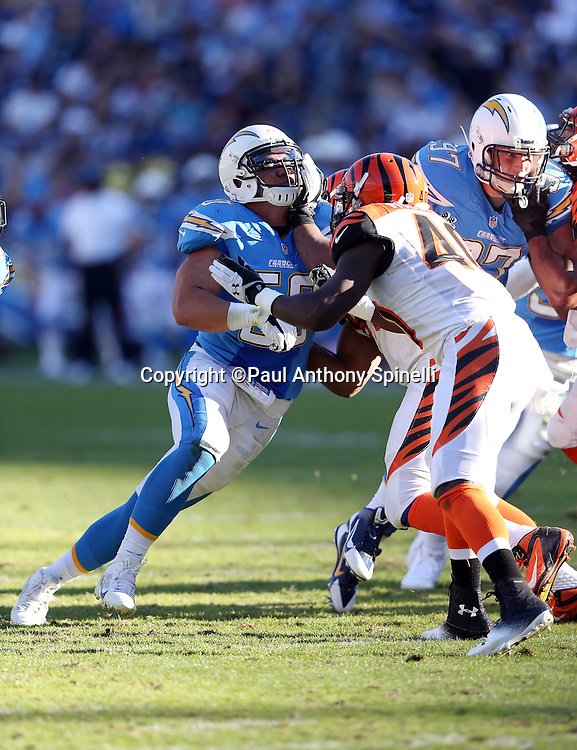 San Diego Chargers inside linebacker Manti Te'o (50) works his way around a block by Cincinnati Bengals strong safety Shawn Williams (40) as he chases the action during the NFL week 13 football game against the Cincinnati Bengals on Sunday, Dec. 1, 2013 in San Diego. The Bengals won the game 17-10. ©Paul Anthony Spinelli