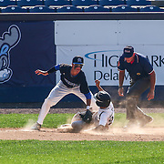 Caravel Academy Infielder Tyler Longinotti (24) slides into third base during a DIAA baseball semifinal game between Caravel Academy and Middletown at Frawley Stadium Saturday May 28, 2016 in Wilmington.