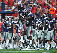 Ole Miss' Charles Sawyer (3) celebrates with Ole Miss' Joel Kight (15) following his interception of a Georgia quarterback Aaron Murray (11) pass at Vaught-Hemingway Stadium in Oxford, Miss. on Saturday, September 24, 2011. Georgia won 27-13.