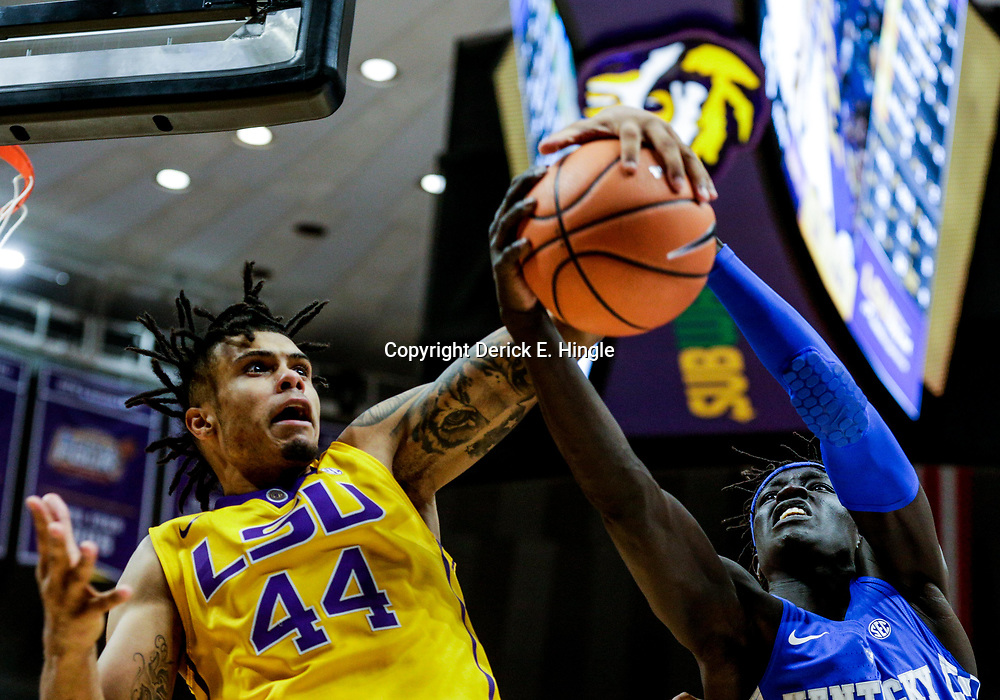 Jan 3, 2018; Baton Rouge, LA, USA; LSU Tigers forward Wayde Sims (44) rebounds over Kentucky Wildcats forward Wenyen Gabriel (32) during the second half at the Pete Maravich Assembly Center. Kentucky defeated LSU 74-71.  Mandatory Credit: Derick E. Hingle-USA TODAY Sports