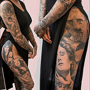 NY Empire State Tattoo Expo Presented by Inked Magazine on July 15 and July 15, 2017at the NYC Midtown Hilton.  For many it was a change to get tattooed by world famous tattoo artists.<br /> <br /> Two views showing her tattoos on her leg and arms.<br /> <br /> Tattoos are no longer just a male thing, young women are just as likely to get a tattoo as males. )<br /> <br /> Body art or tattoos has entered the mainstream it is no longer considered a weird kind of subculture.<br /> <br /> &quot;According to a 2006 Pew survey, 40% of Americans between the ages of 26 and 40 have been tattooed&quot;.