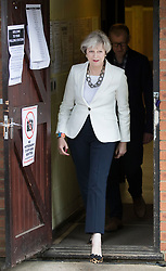 © Licensed to London News Pictures. 08/06/2017. Sonning, UK. Prime Minister Theresa May and her husband Philip leave  their local polling station after casting their vote in the general election. Polling stations are open from 7am - 10pm.  Photo credit: Peter Macdiarmid/LNP