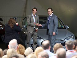 LONDON, ENGLAND - Saturday, June 7, 2014: CEO & Chief Product Architect Elon Musk hands over they keys to the UK's fourth customer of the Model S Mark Ferguson at the UK launch of Tesla Motors' Model S electric car at the Crystal. (Pic by David Rawcliffe/Propaganda)