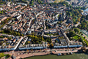 "Nederland, Gelderland, Zurphen, 03-10-2010; overzicht van de binnenstad met Walburgiskerk met Librije gezien vanaf de IJssel, IJsselkade in de voorgrond..Overview of the town with St. Walburgis (Saint Walpurga) church, and its chapter-house (""Librije""), seen from the river IJssel..luchtfoto (toeslag), aerial photo (additional fee required).foto/photo Siebe Swart"