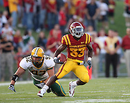 September 3, 2009: Iowa State running back Alexander Robinson (33) cuts back as North Dakota State defensive end Coulter Boyer (92) tries to make a diving tackle during the first half of the Iowa State Cyclones' 34-17 win over the North Dakota State Bison at Jack Trice Stadium in Ames, Iowa on September 3, 2009.