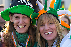 London, March 13th 2016. The annual St Patrick's Day Festival takes place in Trafalgar Square with performances on stage and plenty of Irish food and drink for the thousands of revellers.  PICTURED: Two women enjoy the festive atmosphere. ©Paul Davey<br /> FOR LICENCING CONTACT: Paul Davey +44 (0) 7966 016 296 paul@pauldaveycreative.co.uk